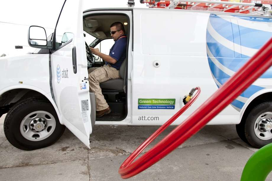 Alejander Ruiz, a premise technical with AT&T, fills up his vehicle with Clean Energy Fuel in Houston. Photo: Thomas B. Shea, For The Chronicle