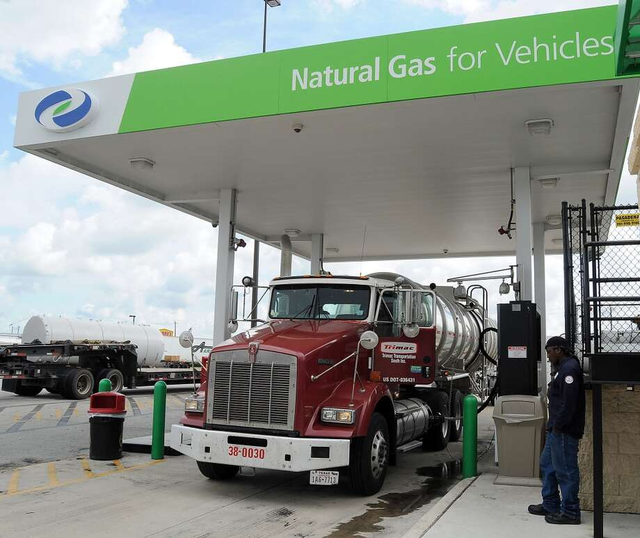 Trimac Transportation driver Robert Williams used the liquified natural gas lane to fill his truck at the Flying J truck stop on I-10 East in Baytown, Texas in August 2012. Photo: Dave Rossman, For The Houston Chronicle