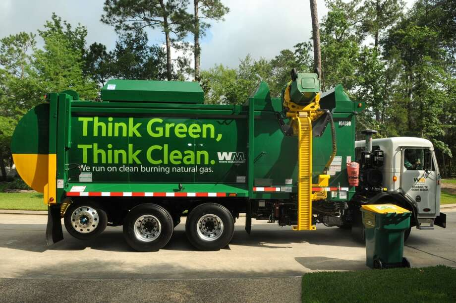 A CNG-powered garbage truck, driven by Servando Rosales, a 14-year veteran of Waste Management, works its route in The Woodlands, Texas on Monday. Photo: Jerry Baker, For The Chronicle