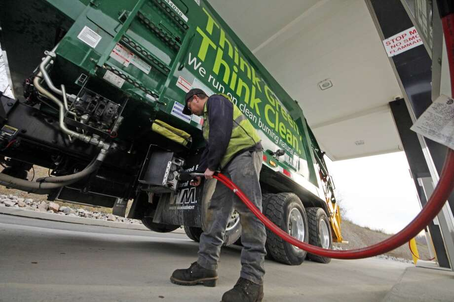 Waste Management driver Alan Sadler fills his truck with compressed natural gas at the company's filling station in Washington, Pa. Photo: Gene J. Puskar, Associated Press