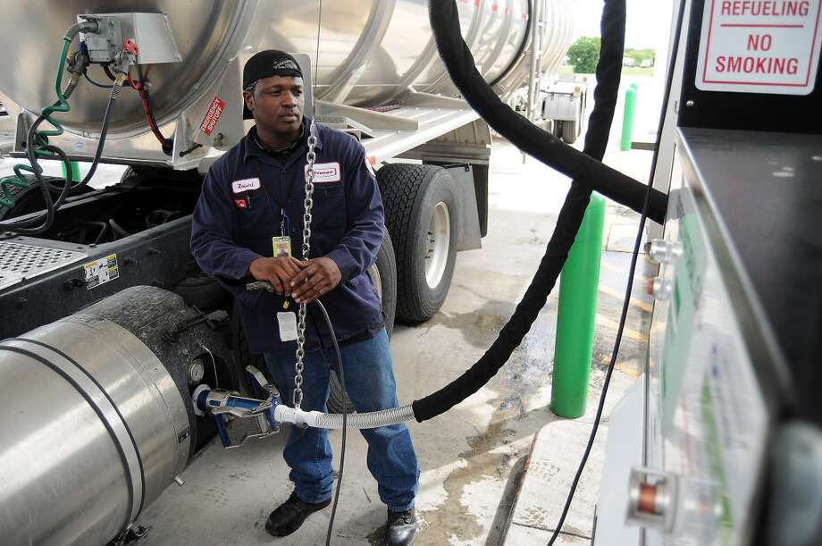 Trimac Transportation driver Robert Williams used the liquified natural gas lane to fill his truck at the Flying J truck stop on I-10 East in Baytown, Texas August 2012. Photo: Dave Rossman, For The Houston Chronicle