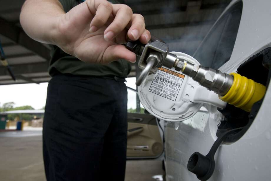 Public Works employee Kacey Roman fuels a 2008 Honda Civic that runs on compressed natural gas at the Lake Jackson, Texas city barn Wednesday, July 23, 2008. Photo: James Nielsen, Houston Chronicle