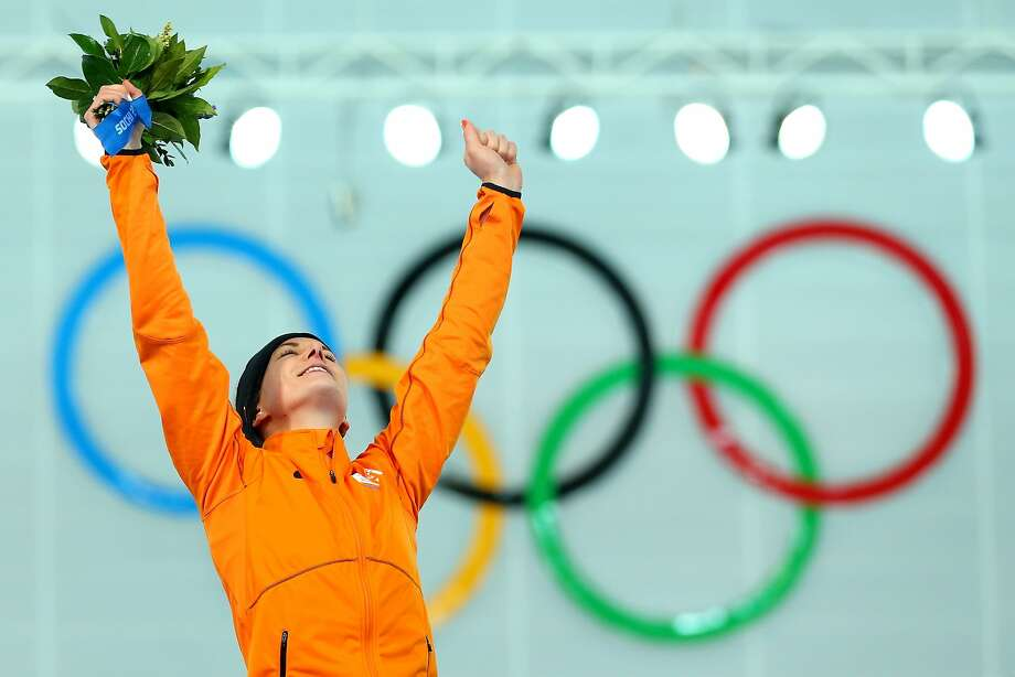 Gold medalist Irene Wust of the Netherlands celebrates on the podium during the flower ceremony for the Women's 3000m Speed Skating event during day 2 of the Sochi 2014 Winter Olympics at Adler Arena Skating Center on February 9, 2014 in Sochi, Russia. Photo: Quinn Rooney, Getty Images