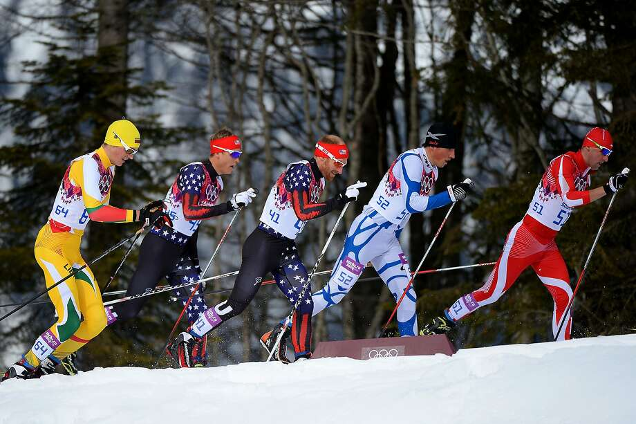 Maciej Kreczmer (R) of Poland leads the pack in the Men's Skiathlon 15 km Classic + 15 km Free during day two of the Sochi 2014 Winter Olympics at Laura Cross-country Ski & Biathlon Center on February 9, 2014 in Sochi, Russia. Photo: Harry How, Getty Images