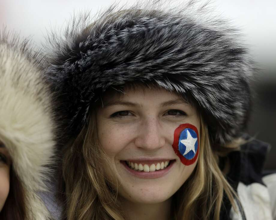 A fan smiles during the women's singles luge training at the 2014 Winter Olympics, Sunday, Feb. 9, 2014, in Krasnaya Polyana, Russia. Photo: Natacha Pisarenko, Associated Press
