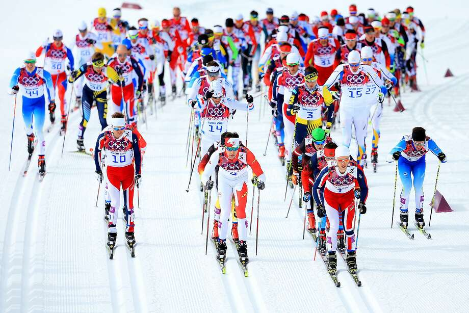 (L-R) Sjur Roethe of Norway, Alex Harvey of Canada and Martin Johnsrud Sundby of Norway lead the pack in the Men's Skiathlon 15 km Classic + 15 km Free during day two of the Sochi 2014 Winter Olympics at Laura Cross-country Ski & Biathlon Center on February 9, 2014 in Sochi, Russia. Photo: Richard Heathcote, Getty Images