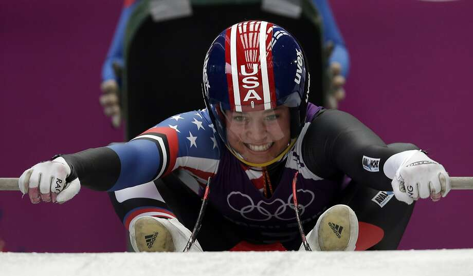 Kate Hansen of the United States starts a run during the women's singles luge training at the 2014 Winter Olympics, Sunday, Feb. 9, 2014, in Krasnaya Polyana, Russia. Photo: Michael Sohn, Associated Press