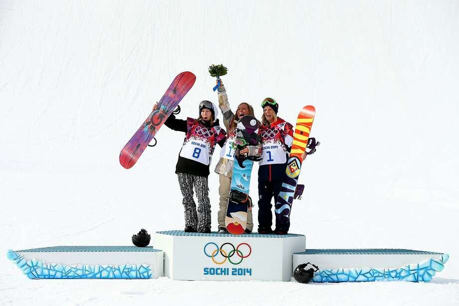 (L-R) Silver medalist Enni Rukajarvi of Finland, gold medalist Jamie Anderson of the United States and bronze medalist Jenny Jones of Great Britain pose on the podium during the flower ceremony for the Women's Snowboard Slopestyle Finals during day two of the Sochi 2014 Winter Olympics at Rosa Khutor Extreme Park on February 9, 2014 in Sochi, Russia.  Photo: Cameron Spencer, Getty Images