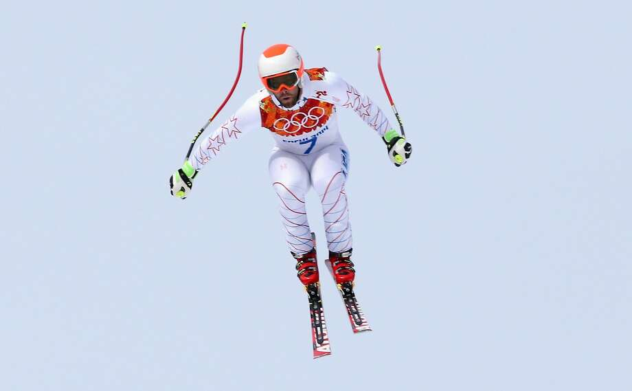 United States' Travis Ganong jumps during the men's downhill at the Sochi 2014 Winter Olympics, Sunday, Feb. 9, 2014, in Krasnaya Polyana, Russia. Photo: Luca Bruno, Associated Press