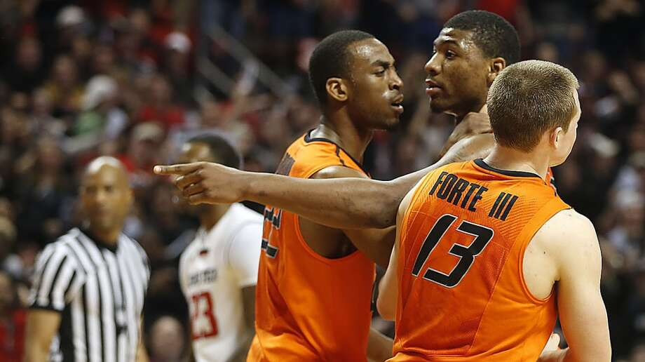 Oklahoma State's Markel Brown(22) and Phil Forte(13) hold Marcus Smart(33) after Smart shoved a fan during their NCAA college basketball game in Lubbock, Texas, Saturday, Feb, 8, 2014. (AP Photo/Lubbock Avalanche-Journal, Tori Eichberger) ALL LOCAL TV OUT Photo: Associated Press
