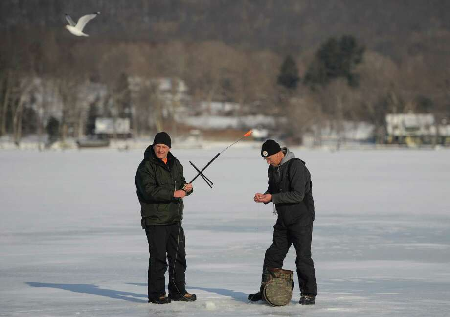 Karol Polowski, left, of Plainview, and Greg Linnhoff, of New Hartford, rig the tip-up while ice fishing on Lake Waramaug in Kent, Conn. on Sunday, Feb. 9, 2014. Photo: Tyler Sizemore / The News-Times