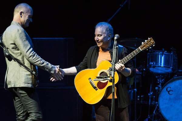 Paul Simon performs with Sting on Saturday, Feb. 8, 2014, at the Toyota Center in Houston. ( Smiley N. Pool / Houston Chronicle )