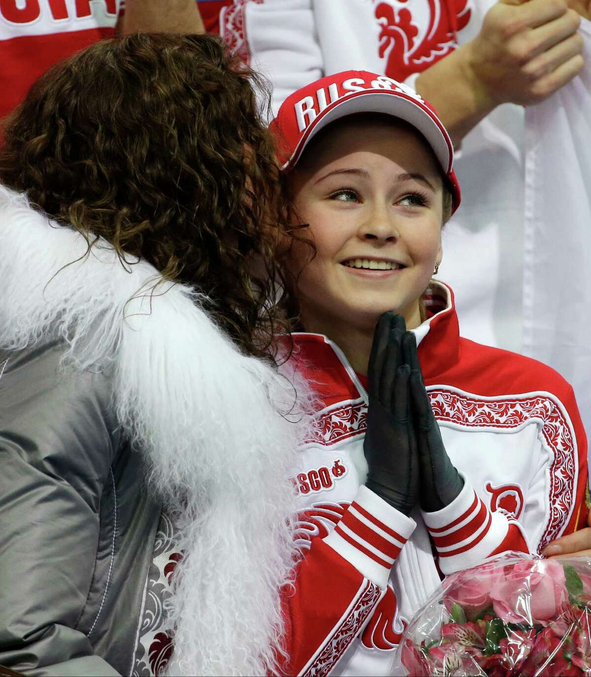 Julia Lipnitskaia of Russia sits in the results area after competing in the women's team free skate figure skating competition at the Iceberg Skating Palace during the 2014 Winter Olympics, Sunday, Feb. 9, 2014, in Sochi, Russia.