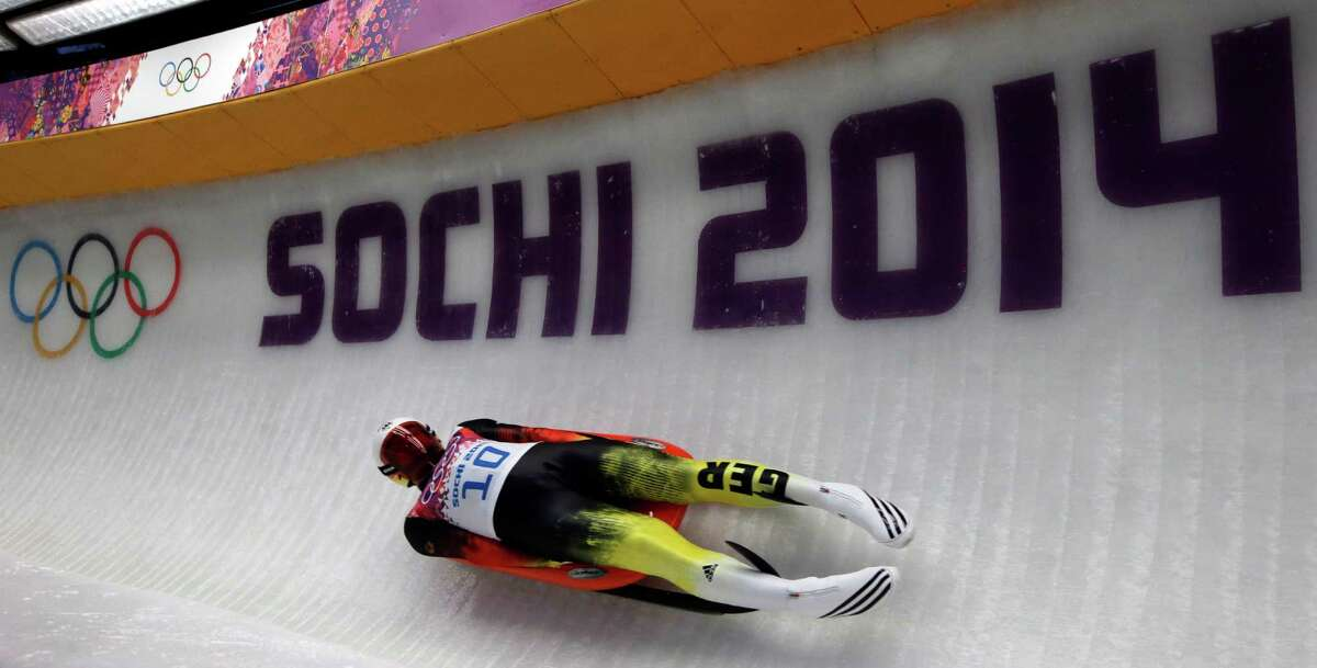 Felix Loch of Germany takes turn five during the men's singles luge final at the 2014 Winter Olympics, Sunday, Feb. 9, 2014, in Krasnaya Polyana, Russia.