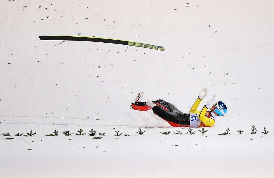 Severin Freund of Germany crashes upon landing during the Men's Normal Hill Individual first round on day 2 of the Sochi 2014 Winter Olympics at the RusSki Gorki Ski Jumping Center on February 9, 2014 in Sochi, Russia. Photo: Lars Baron, Getty Images