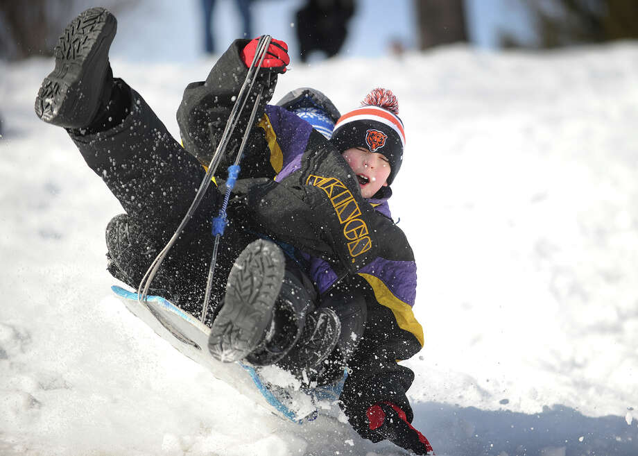 Matthew Diaz, 9, of Stratford, and his cousin Dylan Bennett, 7, of West Haven, careen over a jump during an afternoon of sledding at Boothe Memorial Park in Stratford, Conn. on Sunday, February 9, 2014. Photo: Brian A. Pounds / Connecticut Post