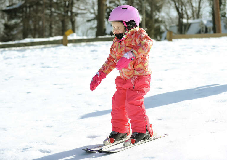 Charlotte, 3, of Stratford, is all smiles as she takes a ski run on Academy Hill in Stratford, Conn.