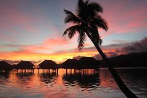 French Polynesia's sensational sunsets come up to the doorsteps of over-the-water bungalows jutting out into a sparkling lagoon.
