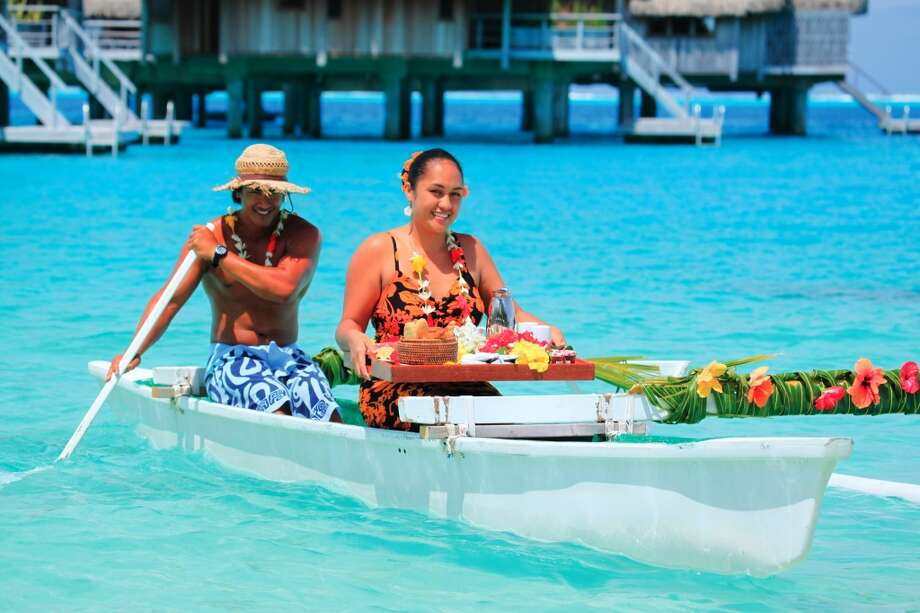 Breakfast is delivered to your bungalow over the water by an outrigger at the Hilton Bora Bora Nui. Photo: Courtesy Photo, Hilton Bora Bora Nui