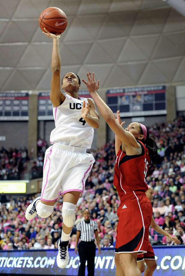 Connecticut's Moriah Jefferson goes up for a basket as Louisville's Tia Gibbs, right, defends during the first half of an NCAA women's college basketball game, Sunday, Feb. 9, 2014, in Storrs, Conn. Jefferson had a career high 18 points as Connecticut defeated Louisville 81-64. Photo: Jessica Hill, AP / Associated Press