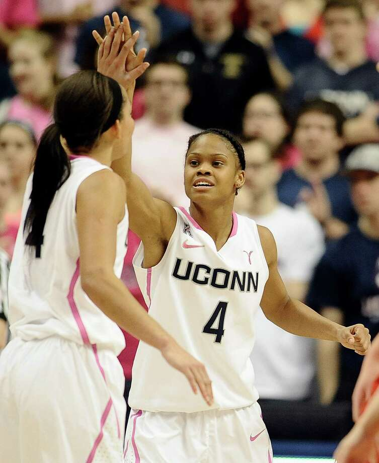 Connecticut's Bria Hartley, left, and Moriah Jefferson slap hands during the second half of an NCAA women's college basketball game, Sunday, Feb. 9, 2014, in Storrs, Conn. Connecticut won 81-64. Photo: Jessica Hill, AP / Associated Press
