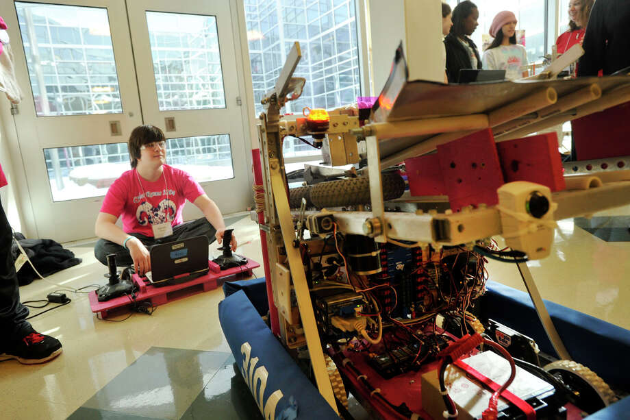 Garret Sampel operates a robot that fires flying discs that he and his fellow Cyber Rams team members built during a demonstration at the 6th annual Junior FIRST Lego League Exposition at the Academy of Information, Technology and Engineering in Stamford, Conn., on Sunday, Feb. 9, 2014. Photo: Jason Rearick / Stamford Advocate