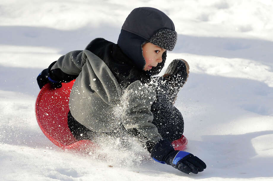 Gabriel Amortegui braces himself before wiping out while sledding down a hill at Scalzi Park in Stamford, Conn., on Sunday, Feb. 9, 2014. Photo: Jason Rearick / Stamford Advocate