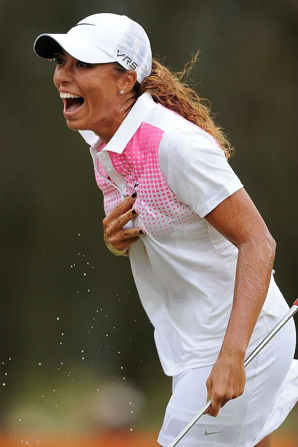 Cheyenne Woods celebrates winning the 2014 Australian Ladies Masters in Gold Coast. Photo: Matt Roberts, Getty Images