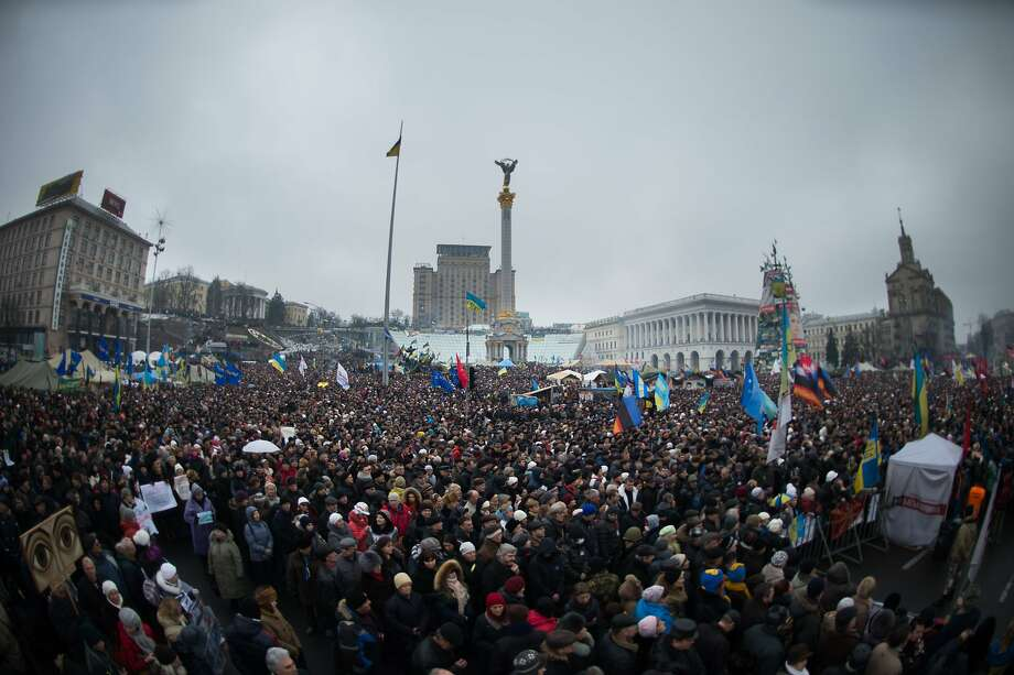 Thousands of demonstrators rally in Independence Square in the heart of the Ukranian capital Kiev to protest President Viktor Yanukovych's authoritarian rule and back closer ties to the European Union. Photo: Martin Bureau, AFP/Getty Images