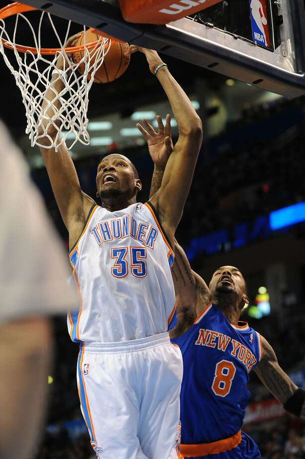 Oklahoma City's Kevin Durant takes the ball to the basket in front of Knicks guard J.R. Smith. Photo: Mark D. Smith, Reuters