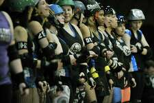 Members of the Albany All Stars Roller Derby team line up before the start of the second half in their competition against The Derailing Darlings at the Washington Avenue Armory on Sunday, Feb. 9, 2014 in Albany, NY.  The next home event for the Albany All Stars will be on March 1st.   (Paul Buckowski / Times Union)