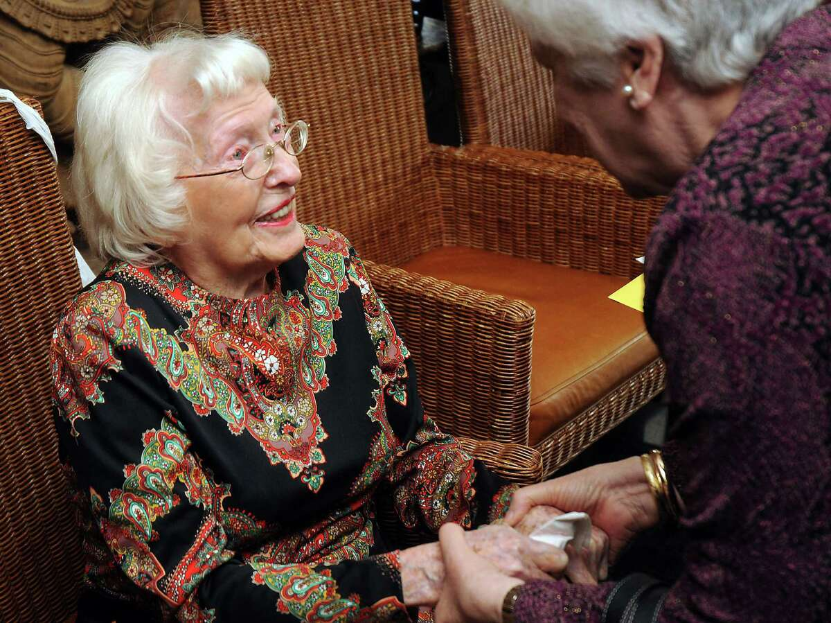Beulah Lackner is greeted by guests at her 106th birthday party at Kiran's Restaurant on Sunday. Lackner was born in Missouri on Feb. 8, 1908, during a time in which her doctor rode a buggy to her home to deliver her.