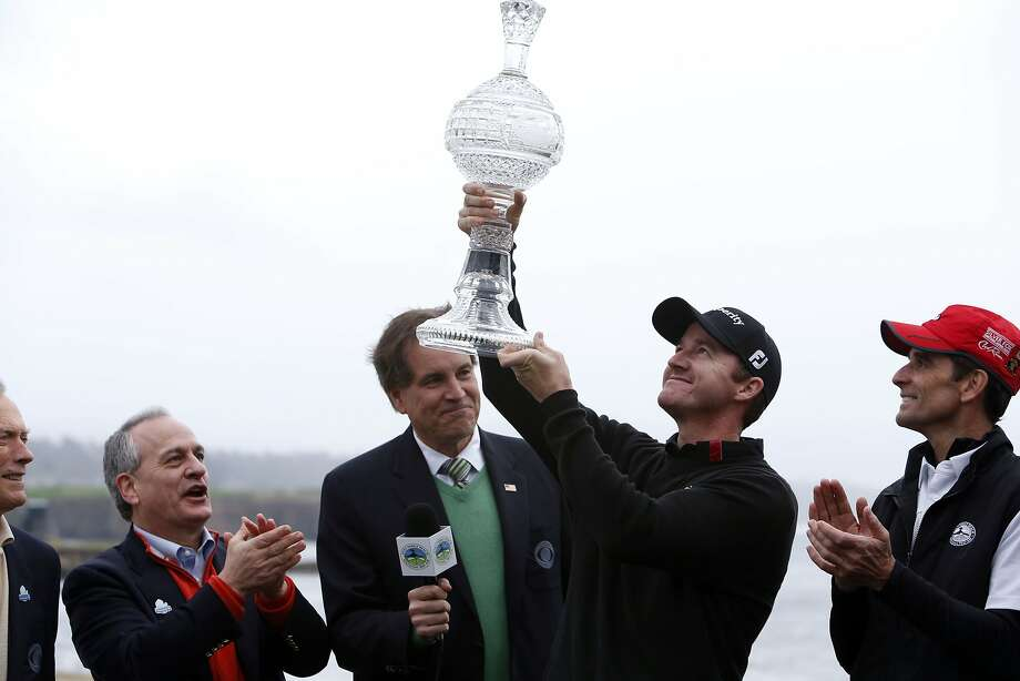 Jimmy Walker provided drama as his six-shot lead shrunk to one, but ultimately he hoisted the winner's trophy. Photo: Michael Macor, The Chronicle