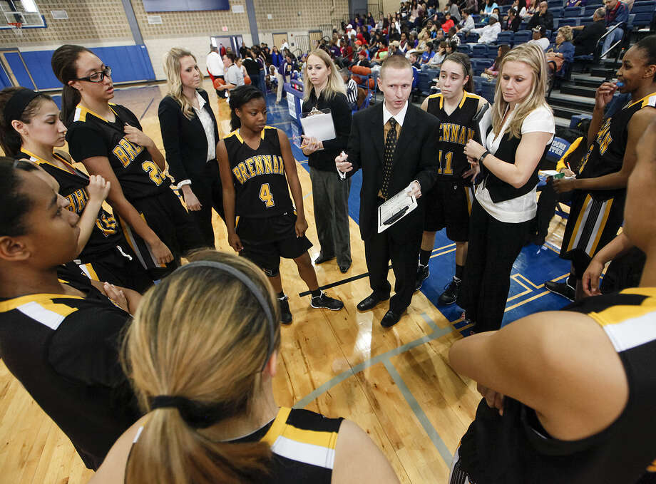 Brennan coach Koty Cowgill (center) has directed his team to a 29-1 mark this season as the Bears bid for a return to the 4A state tournament, where they were semifinalists last season. Photo: Photos By Marvin Pfeiffer / San Antonio Express-News / Prime Time Newspapers 2013