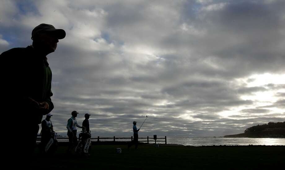 "Send in the clouds (and wind, and rain): ""Crosby weather"" and the PGA Tour returned to Pebble Beach for a weekend stay. Photo: Michael Macor, The Chronicle"