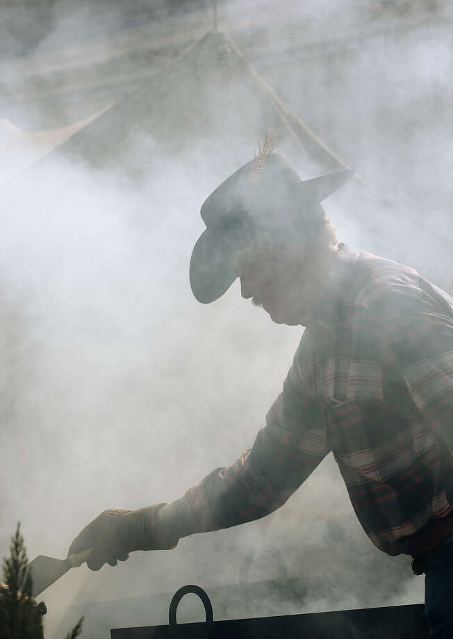 Walt Hood, of ChuckWagon, (cq),Catering,  prepares food for volunteers during the San Antonio Stock Show and Rodeo, Sunday, Feb. 9, 2014. Photo: JERRY LARA, San Antonio Express-News / © 2014 San Antonio Express-News