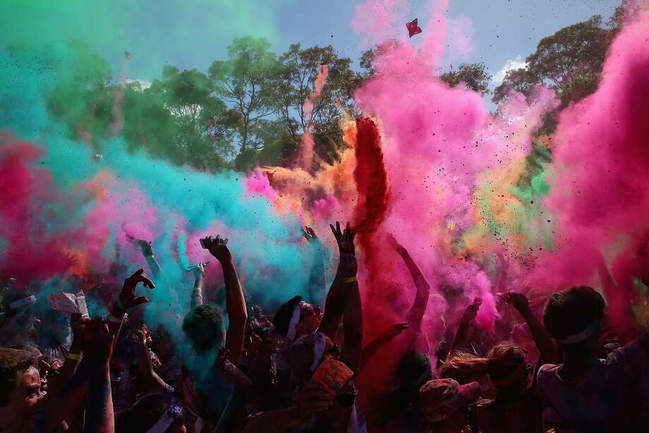 SYDNEY, AUSTRALIA - FEBRUARY 09:  Competitors listen to a DJ set and throw packets of coloured powder after finishing the Color Run at Sydney Olympic Park on February 9, 2014 in Sydney, Australia.  (Photo by Mark Kolbe/Getty Images) *** BESTPIX *** Photo: Mark Kolbe, Getty Images