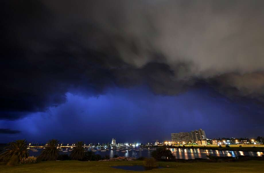 Lightning lights up the sky over the Port of Buceo during a thunderstorm in Montevideo, early on February 9, 2014.    TOPSHOTS/AFP PHOTO/MARIANA SUAREZMARIANA SUAREZ/AFP/Getty Images Photo: Mariana Suarez, AFP/Getty Images