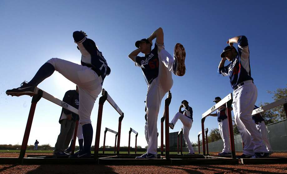 Los Angeles Dodgers pitchers workout during spring training baseball practice Sunday, Feb. 9, 2014, in Glendale, Ariz. (AP Photo/Paul Sancya) Photo: Paul Sancya, Associated Press