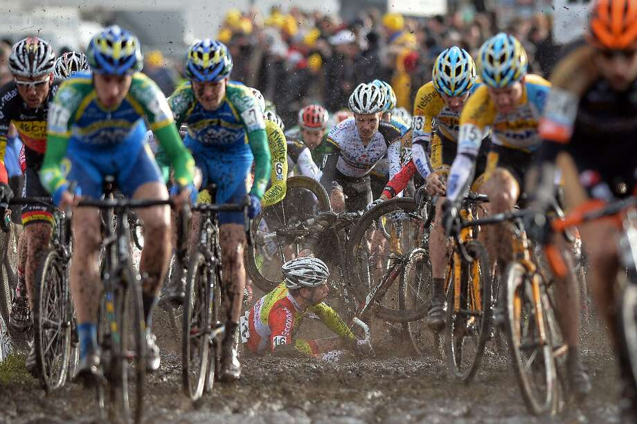 Muck racer:Germany's Marcel Meisen falls at the start of the seventh stage of the Superprestige 
