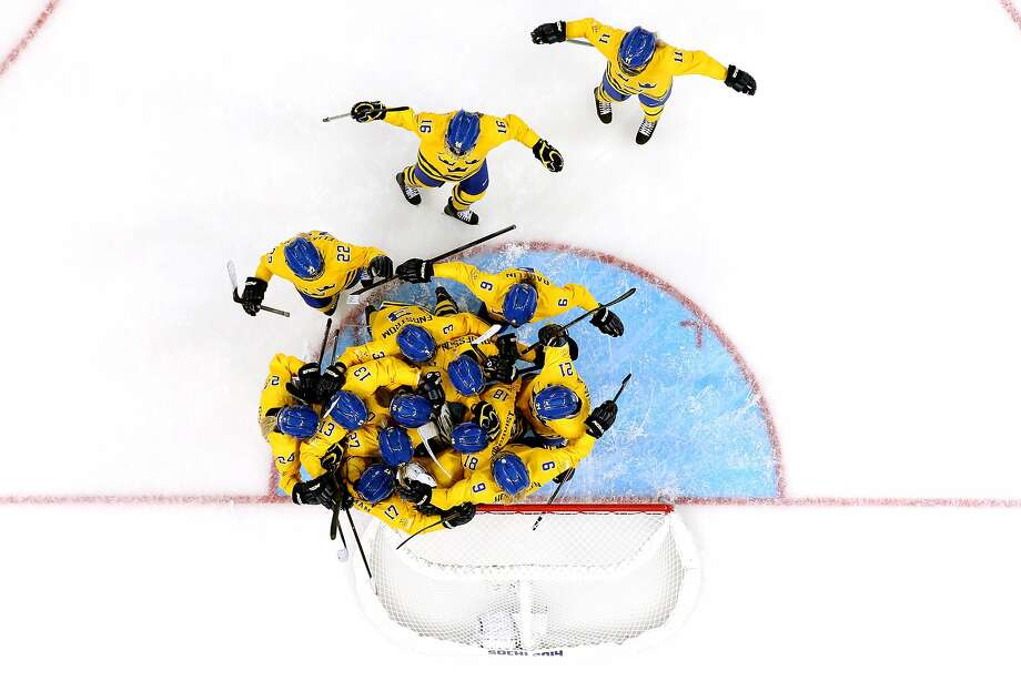 SOCHI, RUSSIA - FEBRUARY 09:  Members of the Sweden ice hockey team celebrate their 1-0 win over Japan during the Women's Ice Hockey Preliminary Round Group B Game on day two of the Sochi 2014 Winter Olympics at Shayba Arena on February 9, 2014 in Sochi, Russia.  (Photo by Bruce Bennett/Getty Images) *** BESTPIX *** Photo: Bruce Bennett, Getty Images