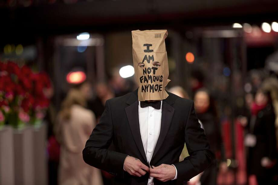Actor Shia LaBeouf poses for photographers, with a paper bag over his head that says 'I am not famous anymore' on the red carpet for the film Nymphomaniac at the International Film Festival Berlinale in Berlin, Sunday, Feb. 9, 2014. (AP Photo/Axel Schmidt) Photo: Axel Schmidt, Associated Press