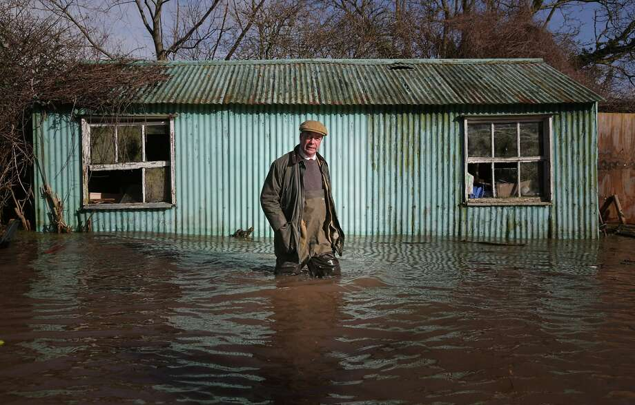 BRIDGWATER, ENGLAND - FEBRUARY 09:  Leader of UKIP Nigel Farage wades in water as he visits a flooded property at Burrowbridge on the Somerset Levels on February 9, 2014 near Bridgwater, England. The party leader's visit to flood stricken area, comes as weather forecasters warn of more wet and windy weather to come.  (Photo by Matt Cardy/Getty Images) *** BESTPIX *** Photo: Matt Cardy, Getty Images