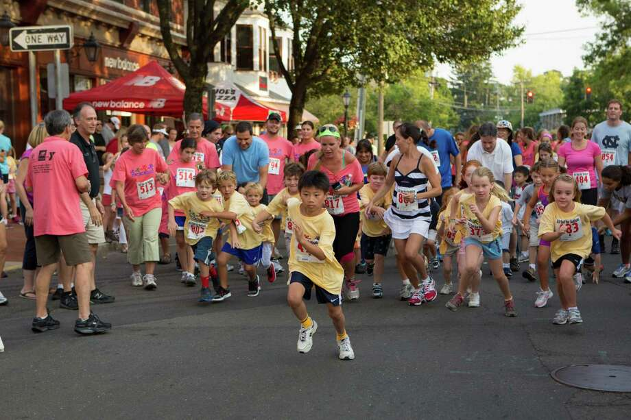 Participants in the fourth annual New Canaan All Out for Autism 5K Walk/Run Road Race Aug. 24, 2012, raised about $17,000 for children with special needs. Photo courtesy of Phil Nelson Photo: Contributed Photo / New Canaan News