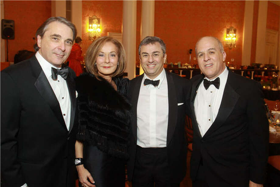 Mark Wawro, from left, Melanie Gray, Michael Zilkha and Rich Levy Photo: Gary Fountain, For The Chronicle