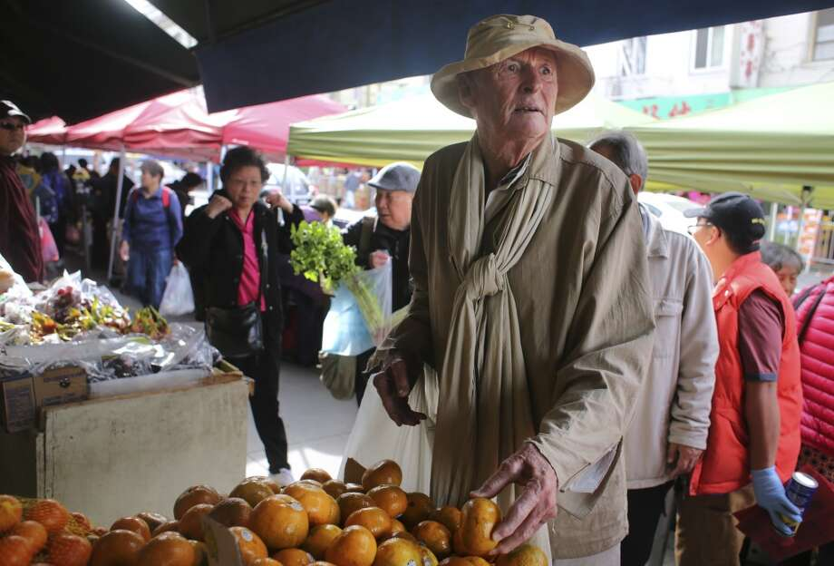 Frank Hatfield, 88, looks through the citrus at an open air produce stand in Chinatown on Tuesday Feb. 2, 2014 in San Francisco, Calif. Photo: Mike Kepka , The Chronicle