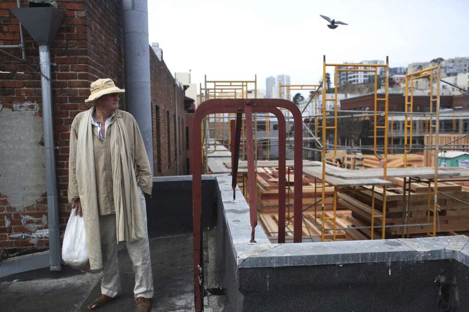 Frank Hatfield, 88, shows off the rooftop view at the Italian American Hotel on Tuesday Feb. 2, 2014 in San Francisco, Calif. Photo: Mike Kepka, The Chronicle