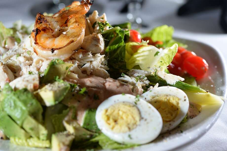 The Grill's crab and shrimp Louis salad is topped with artichoke hearts, seafood, asparagus, a variety of vegetables and a homemade 1,000 island dressing. Photo taken Wednesday, January 22, 2014 Guiseppe Barranco/@spotnewsshooter