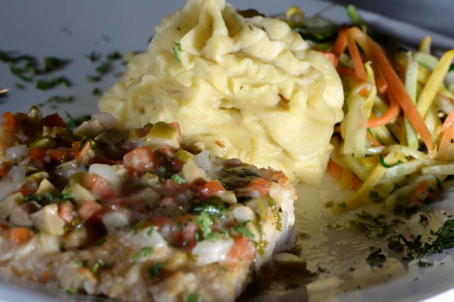 The Grill's butter fish served with mashed potatoes and julian vegetables. Photo taken Wednesday, January 22, 2014 Guiseppe Barranco/@spotnewsshooter