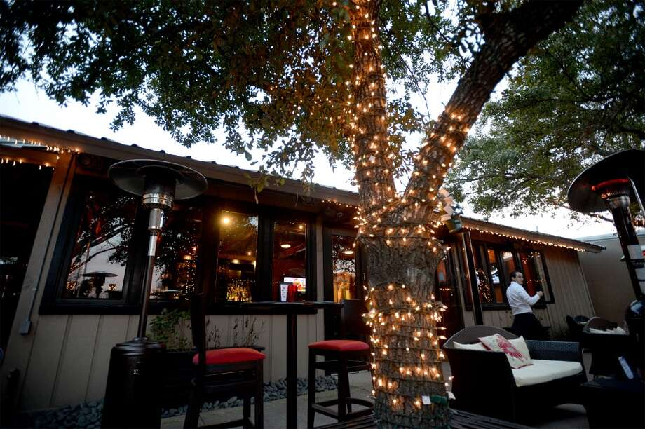 The Grill's outdoor seating allows for dining and socializing in an upscale environment.  Photo taken Wednesday, January 22, 2014 Guiseppe Barranco/@spotnewsshooter